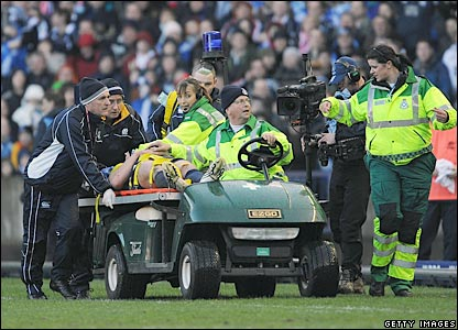 Rory Lamont is taken off on a stretcher after colliding with Iain Balshaw as they chased a kick
