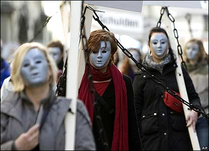 Masked protesters at rally in Bern, Switzerland