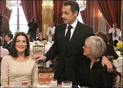 Carla Bruni (left) Nicolas Sarkozy and guest at Elysee Palace lunch