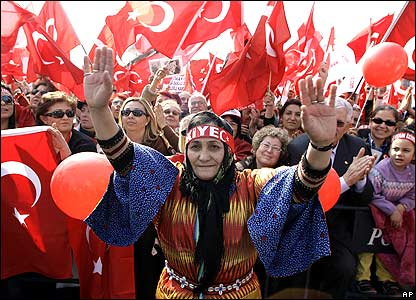 Women waving Turkish flags at Istanbul rally