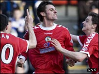 Andy Dorman (centre) celebrates St Mirren's equaliser