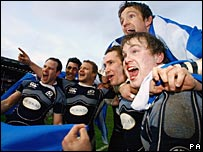 Scotland players celebrate their shock victory on Saturday