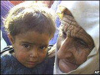 An Afghan child and a grandmother. File photo