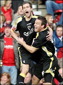 Roger Johnson celebrates scoring Cardiff's second goal