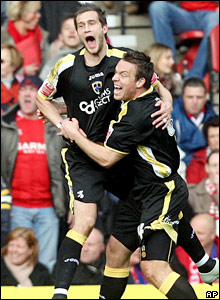A second Bluebirds goal soon arrives courtesy of the head of Roger Johnson (left) who celebrates with Gavin Rae