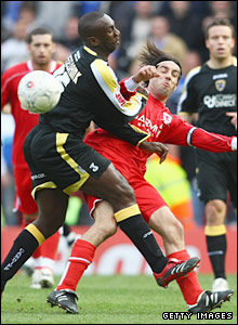 Cardiff striker Jimmy Floyd Hasselbaink enjoys a battle at the Riverside with Boro's Julio Arca