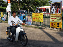 Motorcyclist and campaign posters, Batticaloa, 9 March 2008