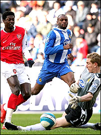 Emmanuel Adebayor is denied by Chris Kirkland early on