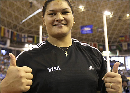 Valerie Vili is all thumbs up after winning gold in the women's shot put