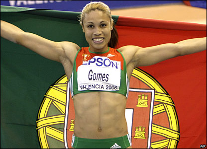 Naide Gomes celebrates with the Portugal flag after winning gold in the long jump
