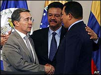 Colombia's Alvaro Uribe shakes hands with Venezuela's Hugo Chavez at a Latin American summit on Friday