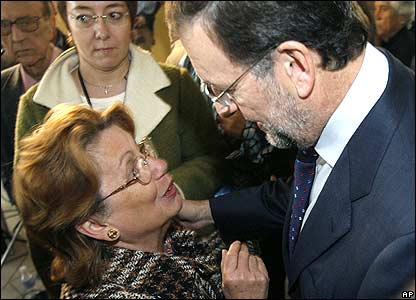 Popular Party leader Mariano Rajoy and woman