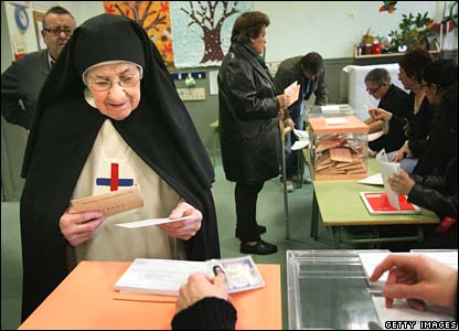 A nun prepares to cast her ballot in Madrid on Sunday