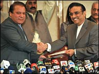 PML-N head Nawaz Sharif, left, agrees a power-sharing deal with the PPP's Asif Ali Zardari