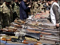 Weapons confiscated from militants in a search operations are displayed for the media at an army base camp in Pakistan's Swat district on Saturday