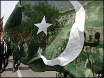 Protesting lawyers seen through Pakistani flag