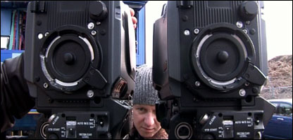 Man peering between 3D camera rig