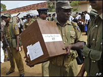 Security personnel carry ballot boxes to polling stations in Batticaloa