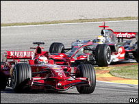 Kimi Raikkonen leads Lewis Hamilton during pre-season testing at Valencia