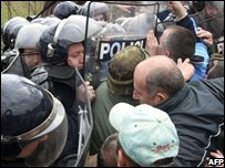 Serbian army reservists confront Serbian riot police in the Kosovan border, 9/03/08