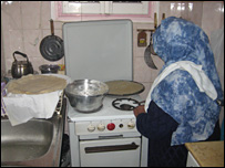 Grandmother Nabawia cooking