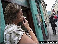 A smoker outside a pub