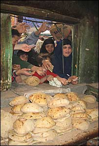 People queuing for bread in the Helwan area of Cairo