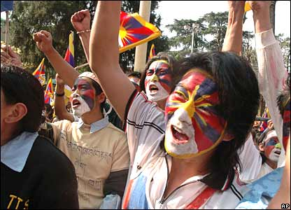 Marchers in Dharamsala, India, shout slogans