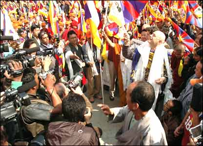 Sergia Delia, member of Italian parliament, waves off marchers in Dharamsala, India