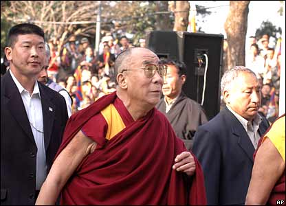 The Dalai Lama arrives a an event commemorating Tibetan Uprising Day at the Tsuglakhang temple in Dharamsala, India