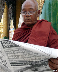 Burmese man reading a newspaper