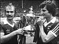 Captain Mick Mills and goalscorer Roger Osborne