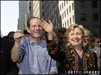 Eliot Spitzer and Hillary Clinton take part in a parade in New York City, Oct 2006