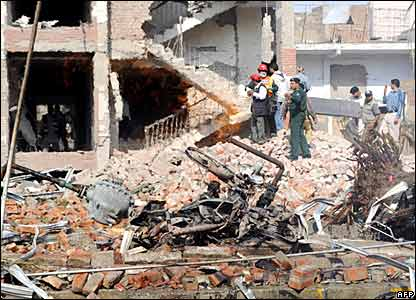 Pakistani rescue workers examine the badly damaged building of the Federal Investigation Agency