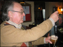 Malachi Curran pulling a pint