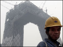 Migrant worker in front of a construction site