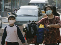 Hong Kong family wearing masks to protect them from bird flu