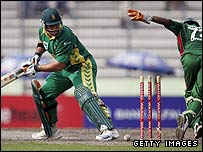Graeme Smith looks back after playing on to Abdur Razzak