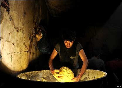 A man handling dough in an Afghan bakery