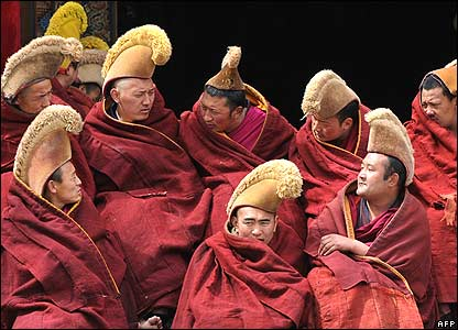 Tibetan monks sitting and chatting