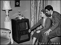 Couple with a black and white television set