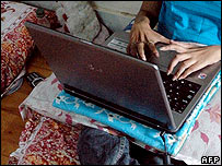 Disabled woman using a laptop computer in India