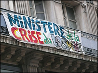 Banner at a former bank used by protesters