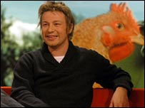 Jamie Oliver with a picture of a chicken