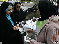 Reformist supporters hand out leaflets in Tehran