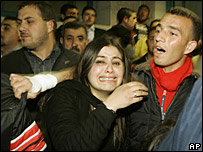 Palestinians mourn the death of four militants killed in a raid in Bethlehem, 12 March 2008