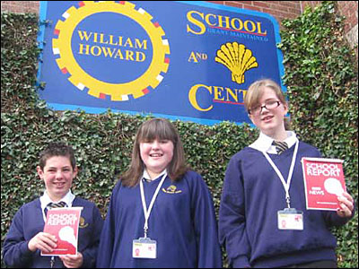 Beth, Maisie and Wilson from William Howard School with School Report notepads.