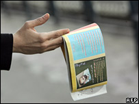Party worker hands out election leaflets in Teheran