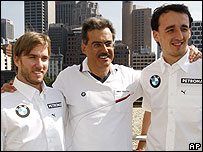 BMW Sauber team boss Mario Theissen flanked by drivers Nick Heidfeld (left) and Robert Kubica