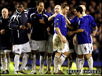 Everton players commiserate Phil Jagielka